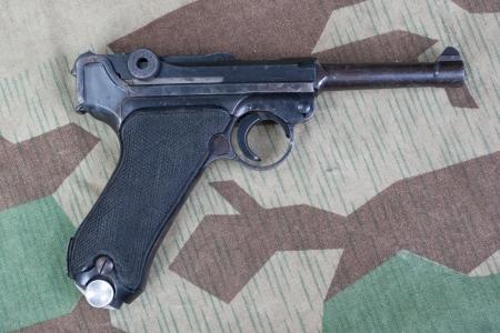 luger: Luger P08 Parabellum handgun on camouflaged background