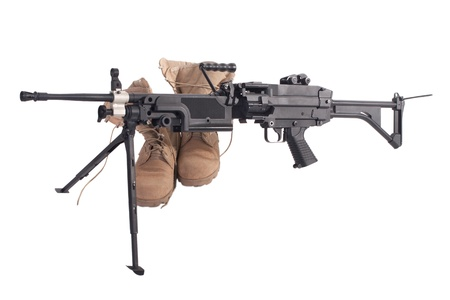 counter terrorism: machine gun and us army combat boots isolated on white