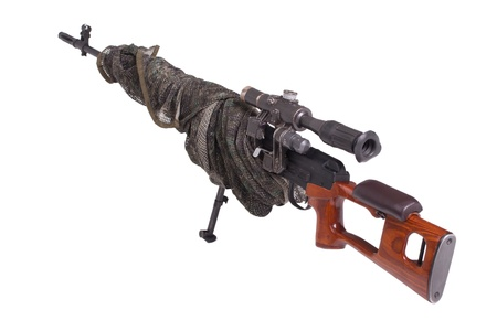 camouflaged: camouflaged sniper rifle