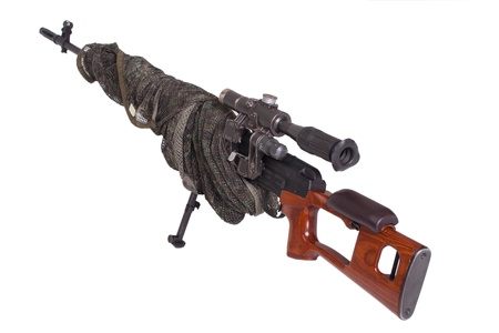 camouflaged: camouflaged sniper rifle with optic sight Stock Photo
