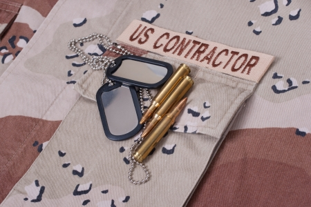 us contractor uniform with dog tags and cartridges   photo