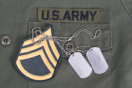 us army: us army uniform with blank dog tags and sergeant rank patch