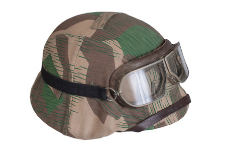 camouflaged: camouflaged nazi german helmet with protective goggles Stock Photo