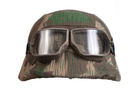 camouflaged nazi german helmet with protective goggles Stock Photo