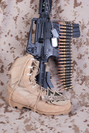 m16 ammo: US Marines concept with firearms, boots and camouflaged uniform