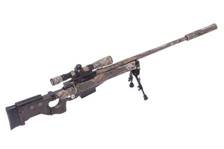 camouflaged sniper rifle with scope Stock Photo