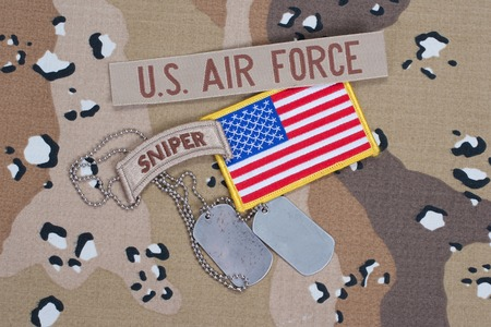 US ARMY sniper tab with blank dog tags on camouflage uniform photo