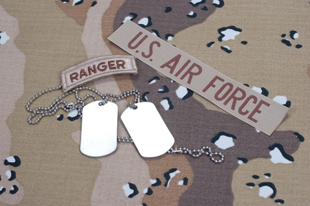 US ARMY ranger tab with blank dog tags on camouflage uniformUS ARMY ranger tab with blank dog tags on camouflage uniform photo