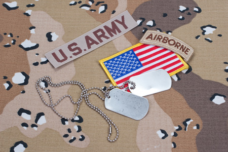 US ARMY airborne tab with blank dog tags on camouflage uniform photo