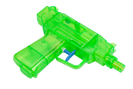 Green plastic water pistol isolated on a white background photo