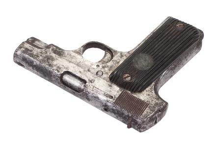 xx century: Old rusty handgun on white