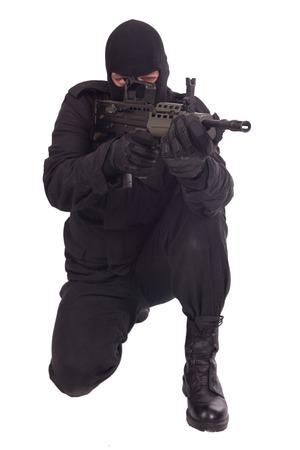 man holding gun: mercenary with l85a1 rifle