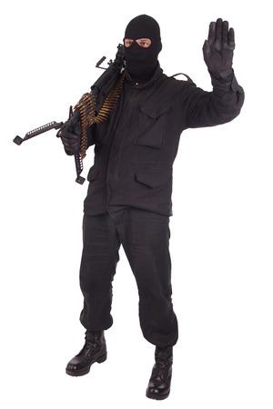 machine gun: mercenary in black uniforms with machine gun
