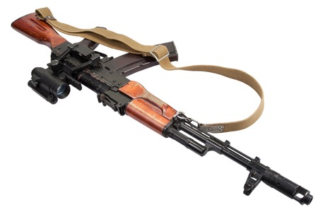 rifle with optic sight on white photo