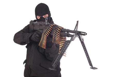 mercenary: mercenary in black uniforms with machine gun