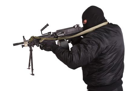 machine gun: robber in black uniform and mask with machine gun Stock Photo