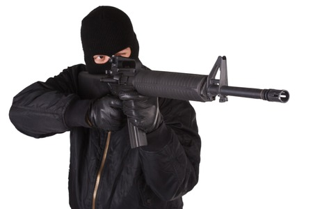 Robber with M16 rifle isolated on white bacground photo