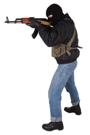 Robber with AK 47 isolated on white bacground