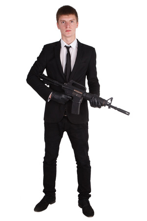 hijacker: man in black costume and rifle isolated on white