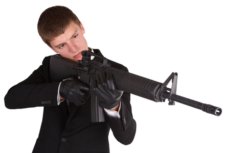 man in black costume and rifle isolated on white photo