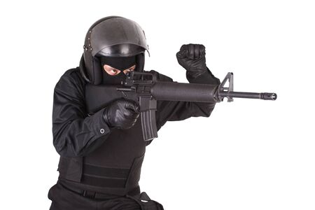 swat teams: special forces soldier in black uniform isolated on white