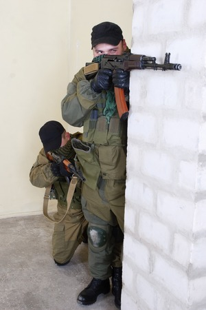 insurgents: insurgents with AK 47 inside the building Stock Photo