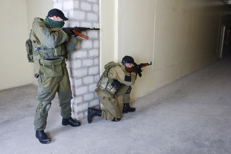 ak 47: insurgents with AK 47 inside the building Stock Photo