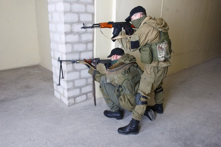 insurgents: insurgents with AK 47 and gun inside the building