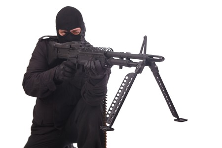 to rebel: rebel in black uniforms with machine gun isolated on white Stock Photo