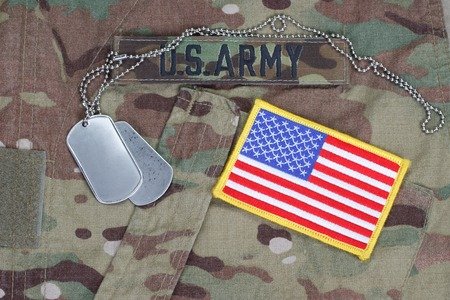 army soldier: us army camouflaged uniform with US flag patch and blank dog tags