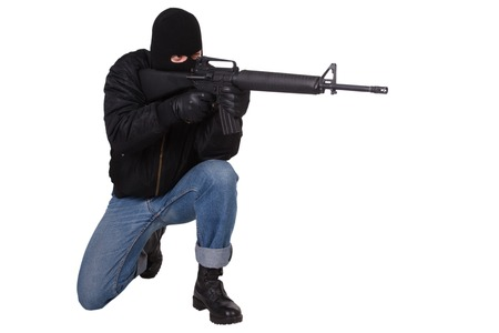 m16: Robber with M16 rifle isolated on white background