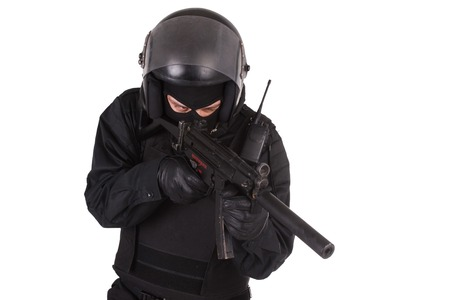 swat teams: Riot police officer in black uniform isolated on white Stock Photo