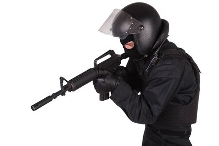 Riot police officer in black uniform isolated on white Stock Photo