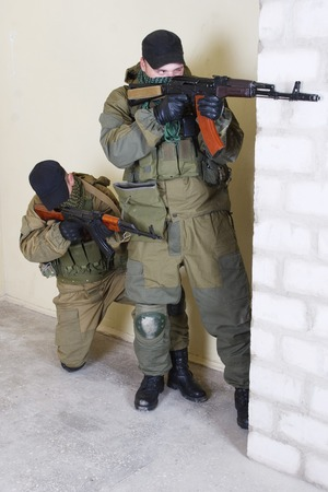 ak 47: rebels with AK 47 inside the building Stock Photo