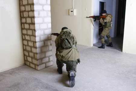 rebels: rebels with AK 47 inside the building Stock Photo