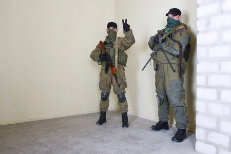 rebels: rebels with AK 47 and machine gun inside the building