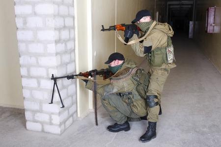 machine gun: rebels with AK 47 and machine gun inside the building