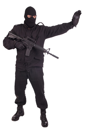 m16: man in black uniform with M16 rifle isolated on white