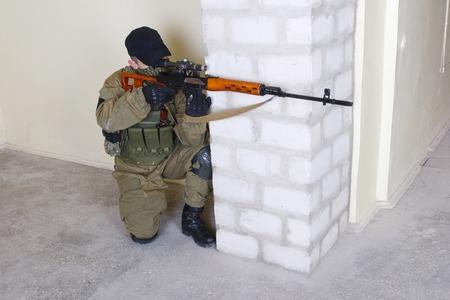 mercenary: mercenary sniper with sniper rifle inside the building