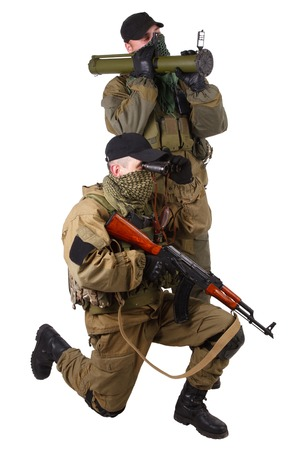 ak 47: mercenaries with AK 47 and rocket launcher  isolated on white background
