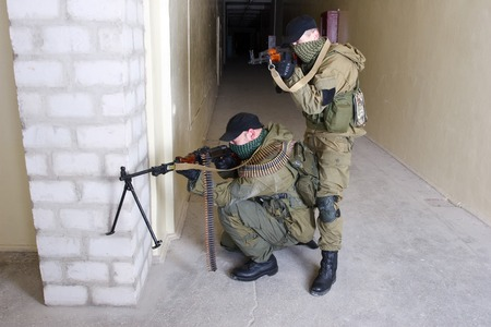 insurgents: insurgents with AK 47 ang RPD gun inside the building