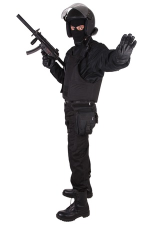 swat teams: police special forces officer in black uniform isolated on white Stock Photo