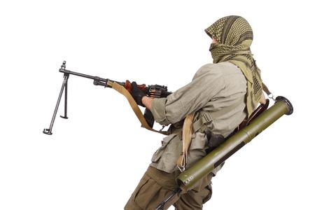 akm: insurgent wearing keffiyeh with machine gun isolated on white Stock Photo
