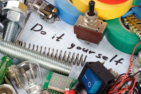 triode: Do it yourself - repair parts on  graph paper background Stock Photo