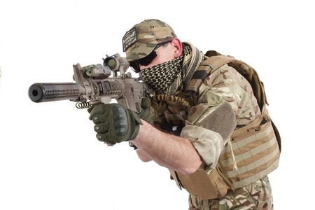 carbine: Private Military Contractor with carbine M4 isolated on white