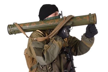 aiming: insurgent wearing shemagh with RPG rocket launcher isolated on white Stock Photo
