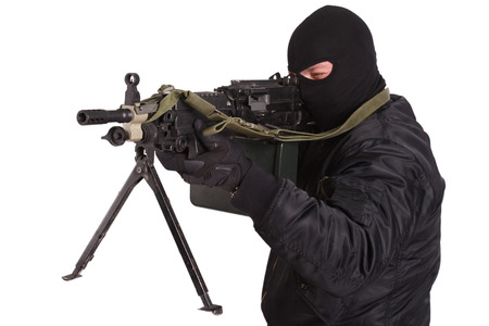 aiming: insurgent in black uniform and mask with machine gun isolated Stock Photo