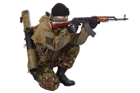 ak47: fighter with ak-47 rifle with kalashnikov rifle isolated on white background