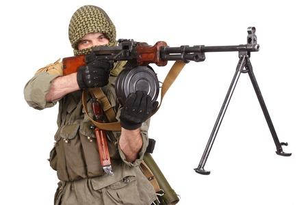 machine gun: insurgent wearing keffiyeh with machine gun isolated on white Stock Photo