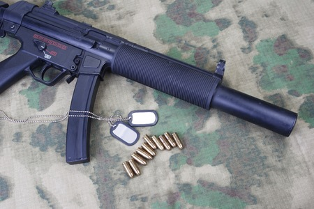 the silencer: submachine gun MP5 with silencer isolated Stock Photo